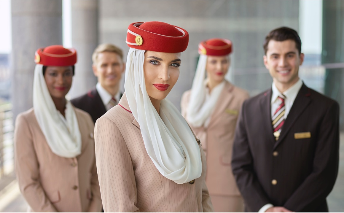 Emirates flight crew in uniform.